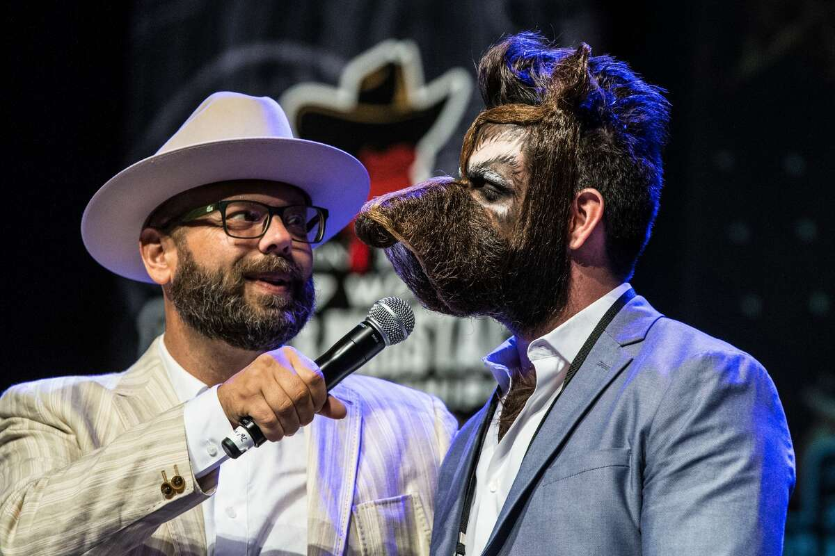 Isaiah Webb, Full Beard Freestyle 2nd place winner and the winner of the Big Joe Johnson Showmanship Award, speaks during the 2017 Remington Beard Boss World Beard & Moustache Championships held at the Long Center for the Performing Arts on September 3, 2017 in Austin, Texas. / AFP PHOTO / SUZANNE CORDEIRO (Photo credit should read SUZANNE CORDEIRO/AFP/Getty Images)