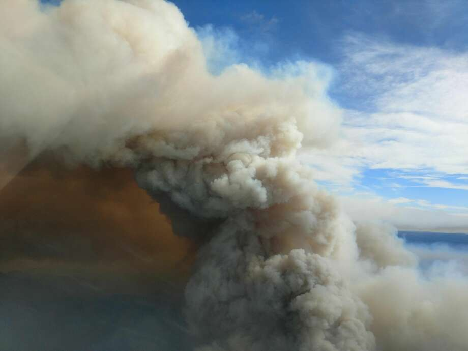 This photo from a plane shows the smoke plume from the Jolly Mountain Fire on August 30. Photo: InciWeb