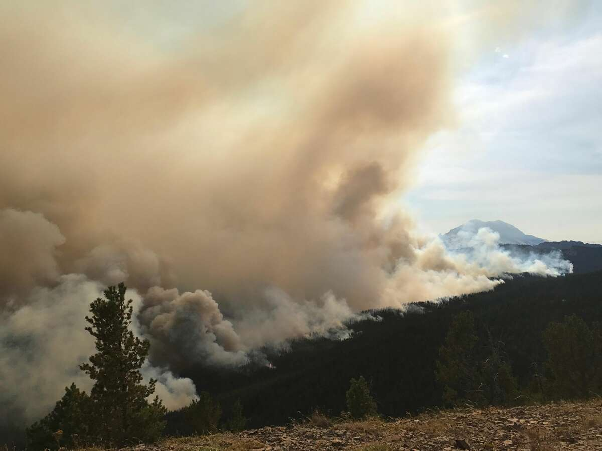 Smoke billows into the air from the Norse Peak Fire Sunday, Sept. 3, 2017. Photo by Jason Emhoff, via InciWeb.