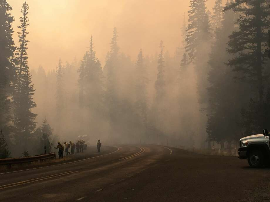 Firefighters holding the line near Union Creek, at the Norse Peak Fire on Sunday, Sept. 3, 2017. Photo by Heather Appelhof, via InciWeb. Photo: Photo By Heather Appelhof, Via InciWeb.