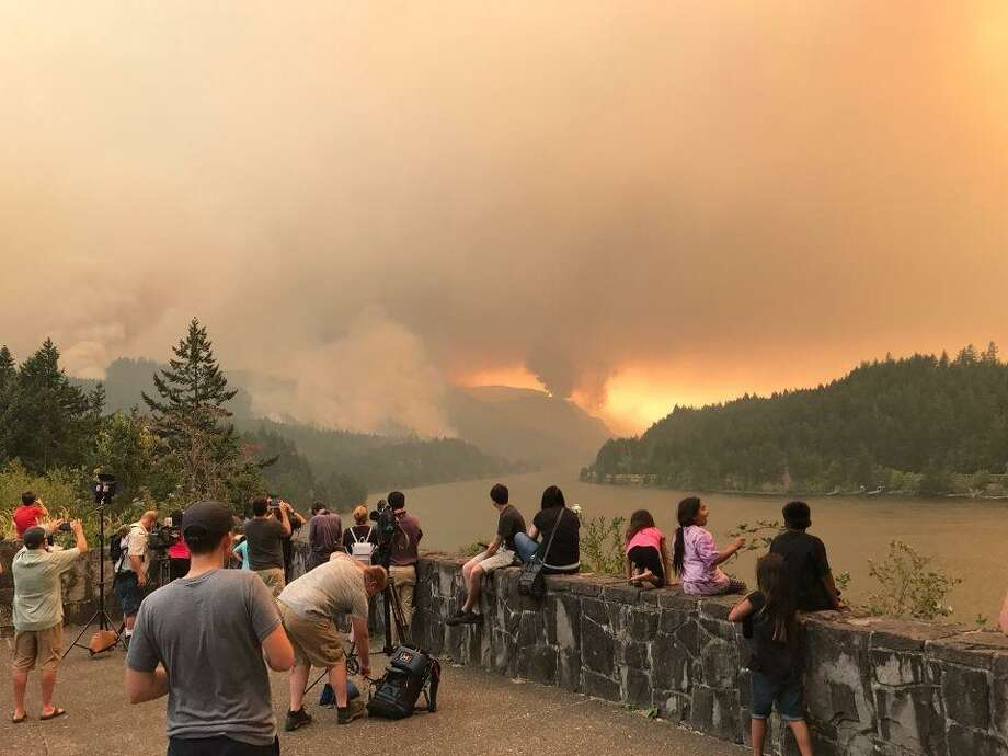 Onlookers watch the Eagle Creek Fire burn in the Columbia River Gorge on Monday, Sept. 4, 2017. Photo: InciWeb
