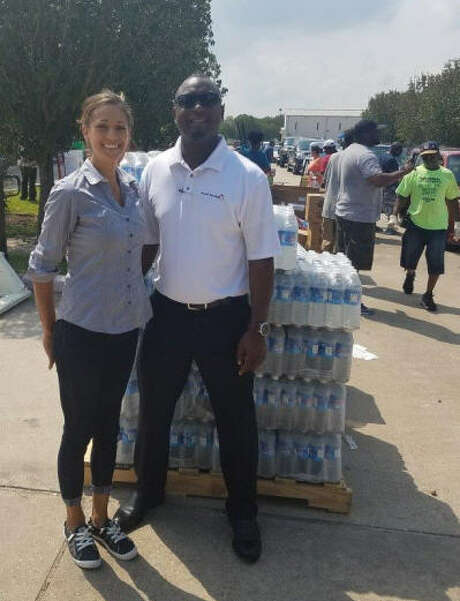 Stafford Sweet Tomatoes Staff Nicole Reichling, assistant general manager, Sweet Tomatoes, in Stafford and Val Matthew, director of operations for Sweet Tomatoes restaurants in Texas and New Mexico,coordinated delivery of bottle water to the Bethel Heavenly Hands church on Labor Day. Photo: Sweet Tomatoes