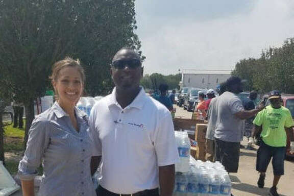Stafford Sweet Tomatoes Staff Nicole Reichling, assistant general manager, Sweet Tomatoes, in Stafford and Val Matthew, director of operations for Sweet Tomatoes restaurants in Texas and New Mexico,coordinated delivery of bottle water to the Bethel Heavenly Hands church on Labor Day.