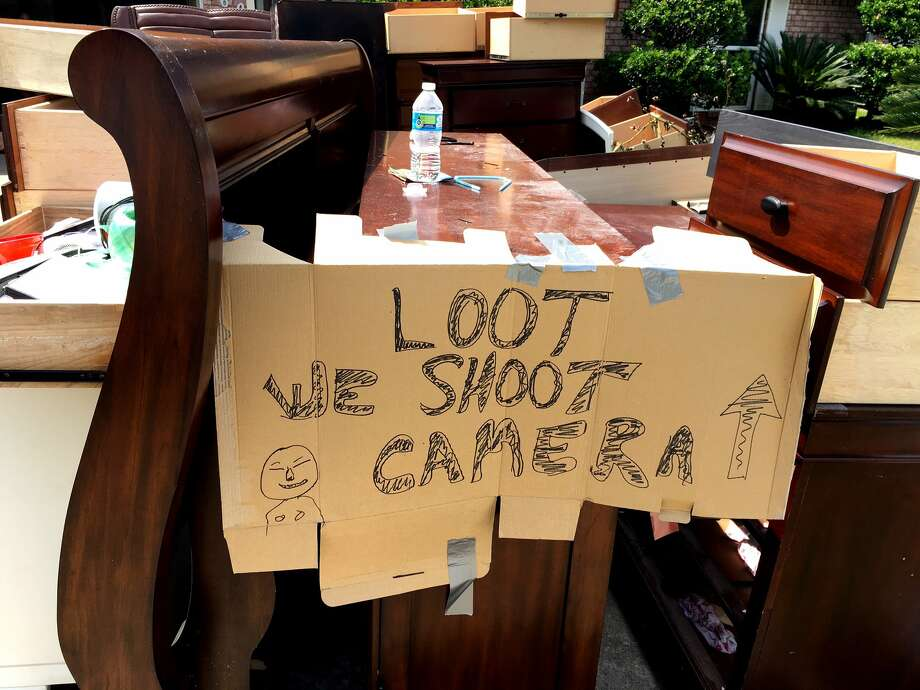 A sign warns looters in a Bridge City neighborhood. Resident said he's waiting for insurance adjuster to inspect. September 5, 2017. Click through to see more Harvey-related signs. Photo: Ryan Pelham