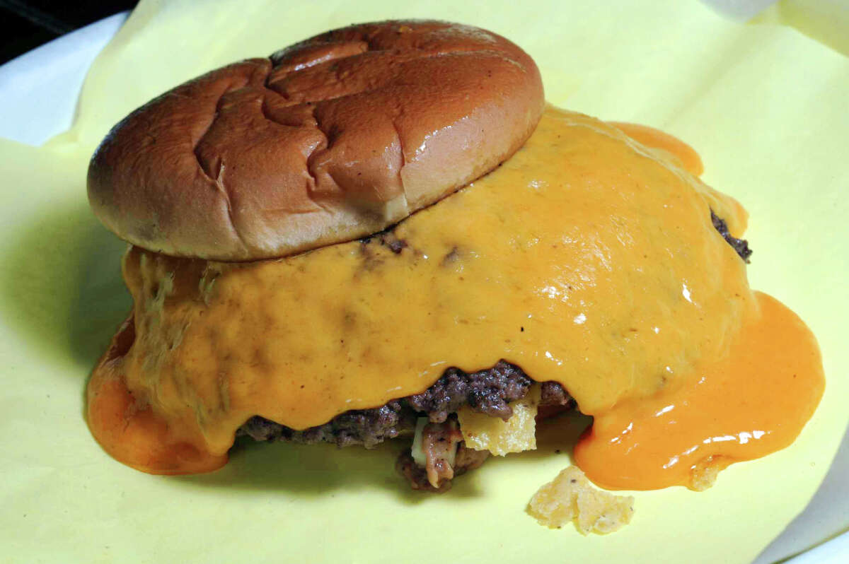 Chris Madrid's, 1900 Blanco Road: Macho size Tostada Burger, loaded with refried beans and melted cheddar.
