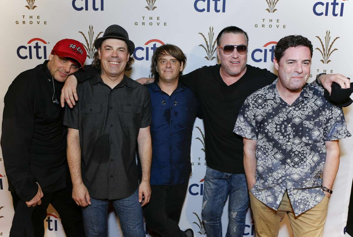 Drummer Randy Cooke (L), bassist Paul De Lisle (2nd from L), keyboard player Michael Klooster (center) and frontman Steve Harwell (2nd from R) of the band Smash Mouth poses for photo at Citi Presents Smash Mouth at The Grove's 2016 Summer Concert Series at The Grove on July 20, 2016 in Los Angeles, California.