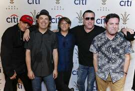 LOS ANGELES, CA - JULY 20:  Drummer Randy Cooke (L), bassist Paul De Lisle (2nd from L), keyboard player Michael Klooster (center) and frontman Steve Harwell (2nd from R) of the band Smash Mouth poses for photo at Citi Presents Smash Mouth at The Grove's 2016 Summer Concert Series at The Grove on July 20, 2016 in Los Angeles, California.
