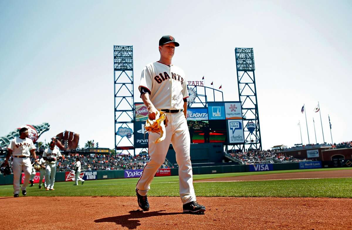 Matt Cain comes off the field after warming up.