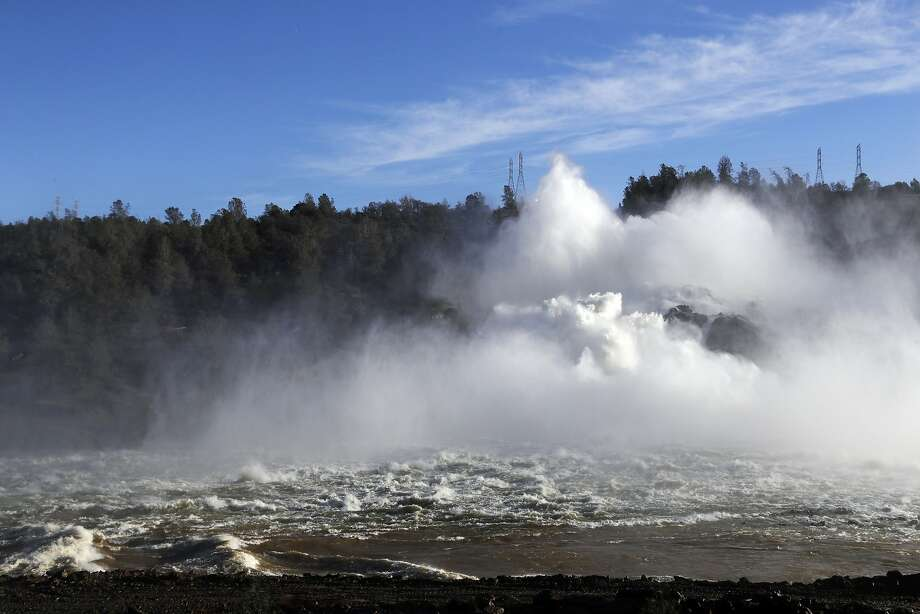 Water gushes from the Oroville Dam's main spillway on Feb. 17. Photo: Marcio Jose Sanchez, Associated Press