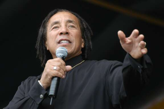 Smokey Robinson performs at The New Orleans Jazz & Heratige Festival in New Orleans, Sunday, May 2, 2004. (AP Photo/Burt Steel)