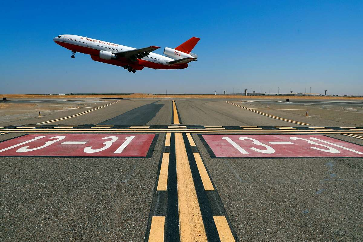 The U.S. Forest Service contracts DC-10's, at the now closed Castle Air Force Base, which is now a municipal airport, to deploy their firefighting retardant jets in Atwater, Ca. on Thurs. August 31, 2017. Merced County is trying to lure more autonomous vehicle companies onto the former base.
