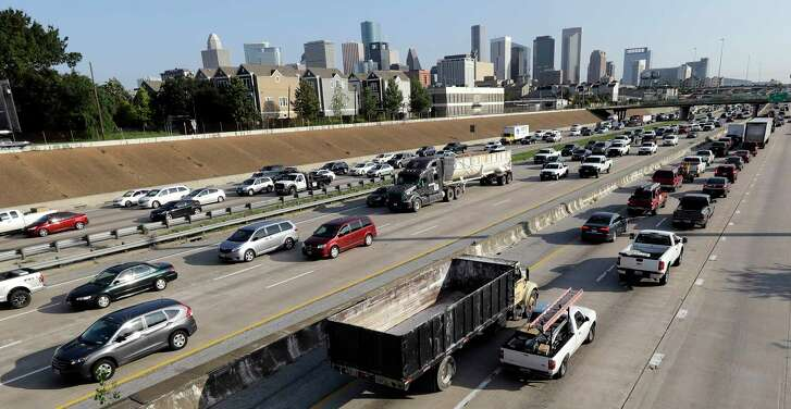 Vehicles travel along the highway near downtown Houston Tuesday, Sept. 5, 2017. Many residents returned to work Tuesday in the aftermath of Hurricane Harvey. (AP Photo/David J. Phillip)