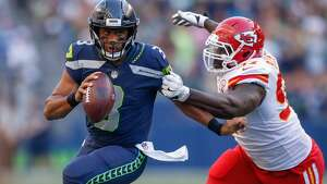SEATTLE, WA - AUGUST 25:  Quarterback Russell Wilson #3 of the Seattle Seahawks rushes under pressure from defensive lineman Allen Bailey #97 of the Kansas City Chiefs at CenturyLink Field on August 25, 2017 in Seattle, Washington.  (Photo by Otto Greule Jr/Getty Images)