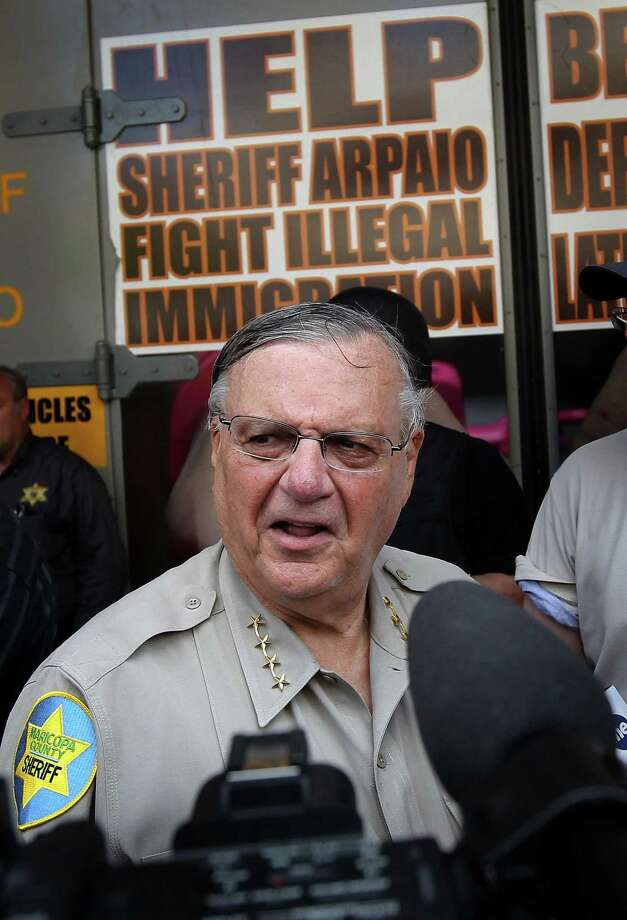 Maricopa County Sheriff Joe Arpaio stands in front of his county jail the day Arizona's immigration enforcement law SB 1070 went into effect on July 29, 2010 in Phoenix, Arizona. Although U.S. District Court Judge Susan Bolton suspended several controversial provisions of the law the previous day, Arpaio said he did not need the law in order to detain undocumented immigrants during his planned crime sweep in Phoenix. Photo: John Moore / / 2010 Getty Images