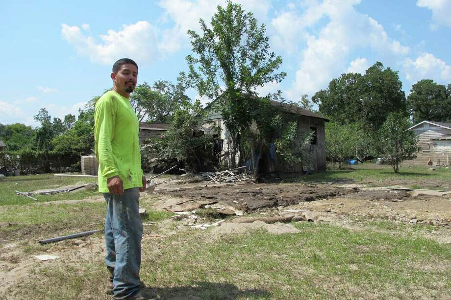 Rafael Casas tours his storm-ravaged property in a small working-class neighborhood that sits between two Superfund sites, French Ltd. and the Sikes Disposal Pits, in Crosby, on Friday. Photo: Jason Dearen /Associated Press / ap