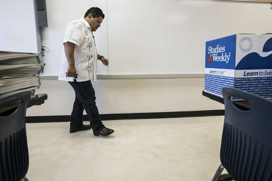 Richard Carranza, Houston Independent School District superintendent, walks through a flood-damaged classroom. Classes are to begin Monday, but some schools are too severely damaged to open. Photo: Brett Coomer, Houston Chronicle