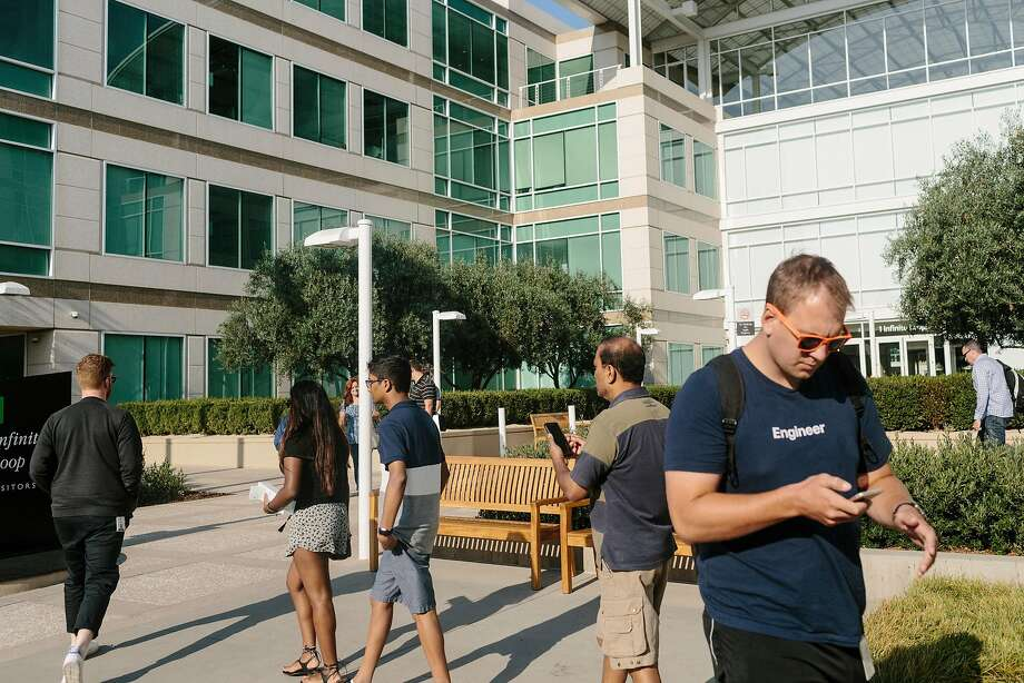 Apple, based in Cupertino, said it has 250 employees who have benefited from work visas under DACA rules. Photo: JASON HENRY, NYT