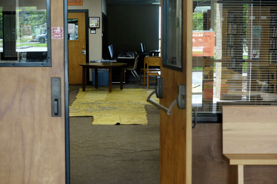 A section of removed carpet can be seen in the Orangefield High School library through a window on Tuesday.  Photo taken Tuesday 9/5/17 Ryan Pelham/The Enterprise Photo: Ryan Pelham / ©2017 The Beaumont Enterprise/Ryan Pelham