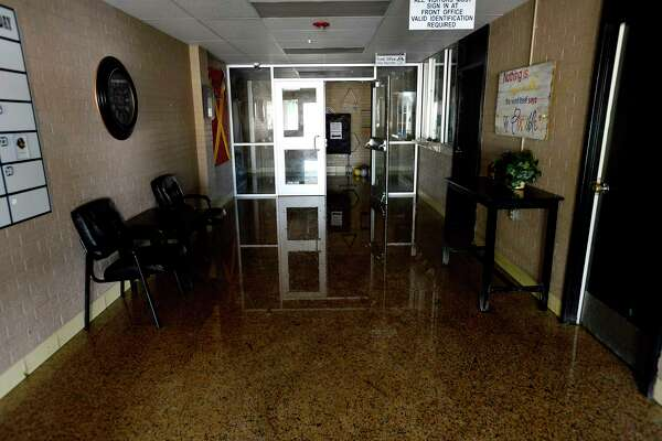Water covers the floor near the main office of Oak Forest Elementary in Vidor on Tuesday.  Photo taken Tuesday 9/5/17 Ryan Pelham/The Enterprise