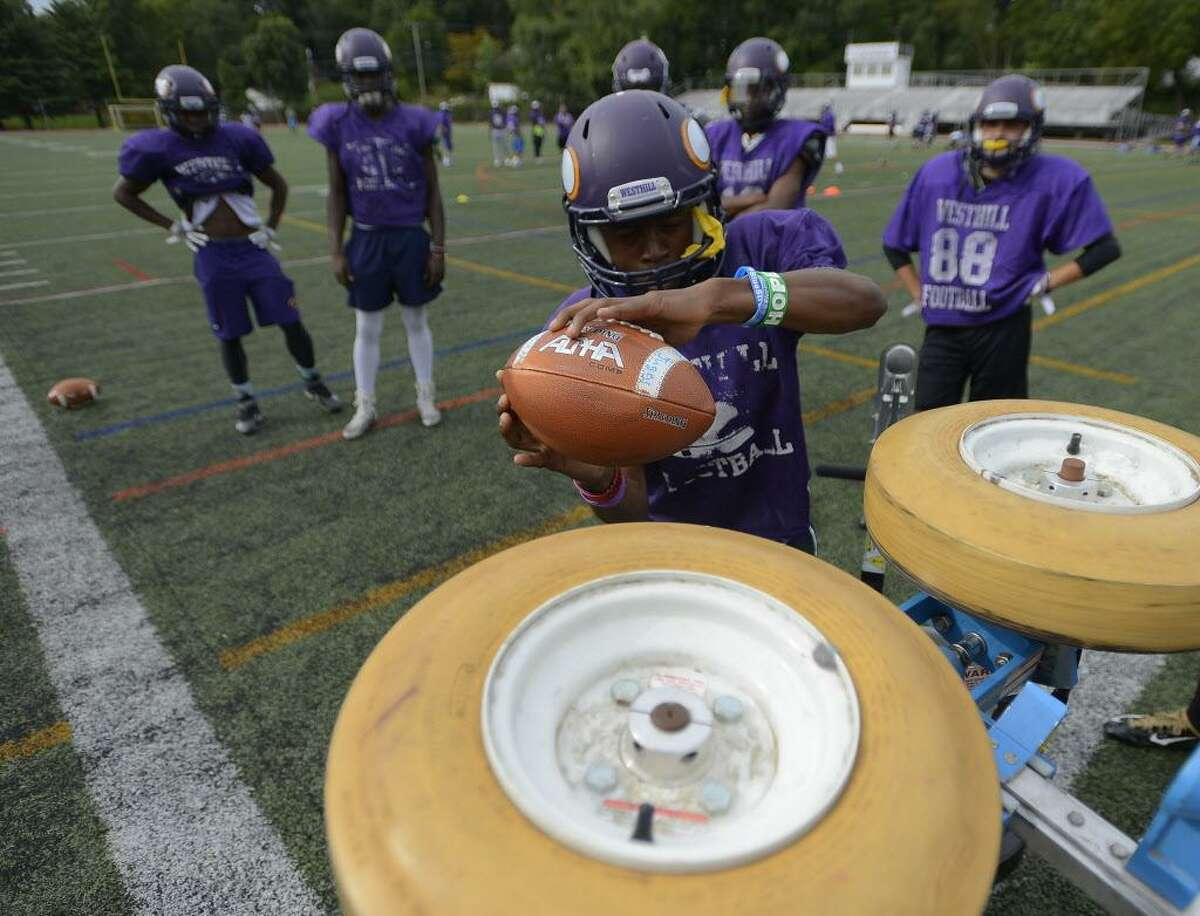 Westhill's Noldylens Metayer works on catching during a team practice at the school in Stamford on Saturday.