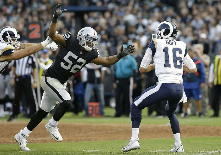 File-This Aug. 19, 2017, file photo shows Oakland Raiders defensive end Khalil Mack (52) sacking Los Angeles Rams quarterback Jared Goff (16) during the first half of an NFL preseason football game in Oakland. Oakland appeared headed for a showdown with New England until Derek Carr went down late in December. Should he stay healthy, the Raiders are the favorites to hold off the Chiefs, who sneaked past them to win the West last season, and the Broncos. The Raiders have difference makers throughout their offense, and a line equal to the Patriots. Defensive Player of the Year Mack is by far their best defender and that unit must come through in a big way in the NFL's best sector. (AP Photo/Rich Pedroncelli, File) Photo: Rich Pedroncelli, Associated Press