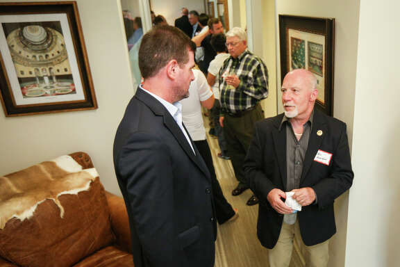 State Sen. Brandon Creighton, R-Conroe, chats with The Woodlands resident John Hennigan during the open house on Tuesday, July 11, 2017, at Sen. Creighton's office in The Woodlands.