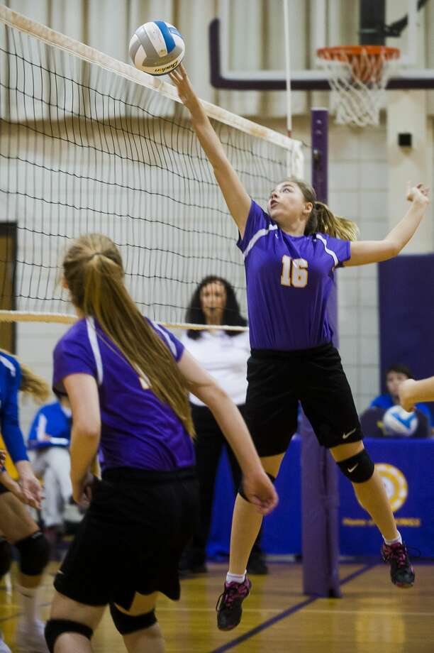 Calvary Baptist Academy sophomore Kaitlin Schmidt tips the ball over the net during a game against Midland Christian School on Tuesday, September 5, 2017 at Calvary Baptist Academy. Photo: (Katy Kildee/kkildee@mdn.net)