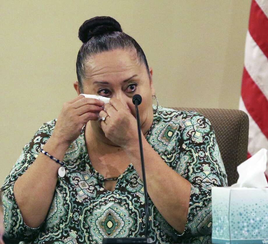Patty Ojeda Quintero sheds tears after seeing a photo of the victim as Gloria R. Proo stands on trial in the 379th State District Court before Judge Ron Rangel on September 5, 2017. Photo: Tom Reel, Staff / San Antonio Express-News / 2017 SAN ANTONIO EXPRESS-NEWS