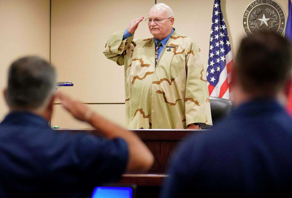 Judge Wayne Christian, center, salutes in Veterans Treatment Court on Aug. 21, 2017, in his County Court-at-Law No. 6 in San Antonio. Christian was admonished by the State Commission on Judicial Standards in an order dated Aug. 12, 2020, for failure to give a defendant due process.