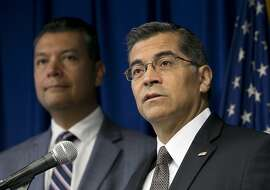 California Attorney General Xavier Becerra, right, flanked by Secretary of State Alex Padilla, discusses the lawsuit he intends to file against the Trump administration over the cancelation of the Deferred Action for Childhood Arrivals program, during a news conference, Tuesday, Sept. 5, 2017, in Sacramento, Calif. (AP Photo/Rich Pedroncelli)
