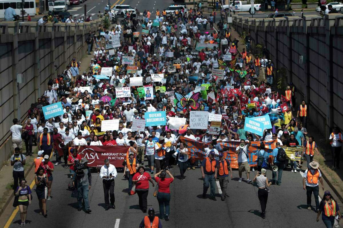 Protesters march towards the Immigration and Customs Enforcement headquarters in Washington. President Donald Trump on Tuesday ordered an end to the Obama-era executive action shielding young undocumented immigrants from deportation, urging Congress to replace it with legislation before it begins phasing out on March 5, 2018. (Tom Brenner/The New York Times)