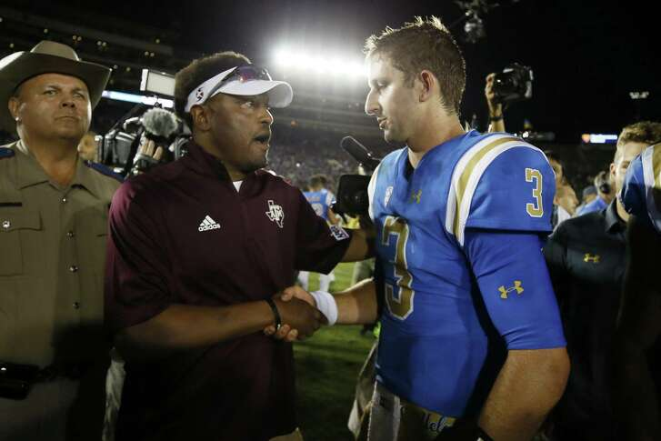 UCLA quarterback Josh Rosen and Texas A&M coach Kevin Sumlin shake hands after the game on Sept. 3, 2017, in Pasadena, Calif. UCLA won 45-44, rallying from a 34-point deficit.