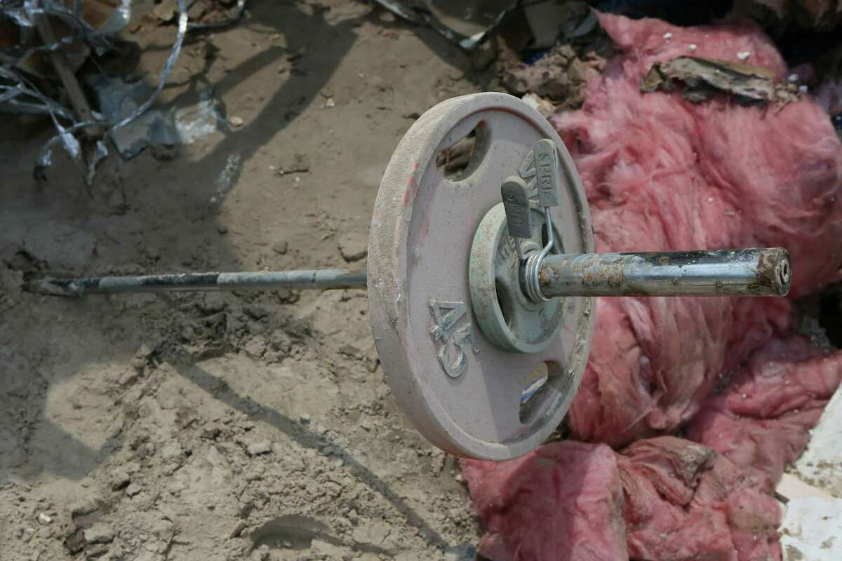 A barbell stuck in the debris at Riverview at Forest Cove complex on Sunday, Sept. 3 at Aqua Vista Drive in Kingwood, TX, following flooding of the San Jacinto River caused by Tropical Storm Harvey.