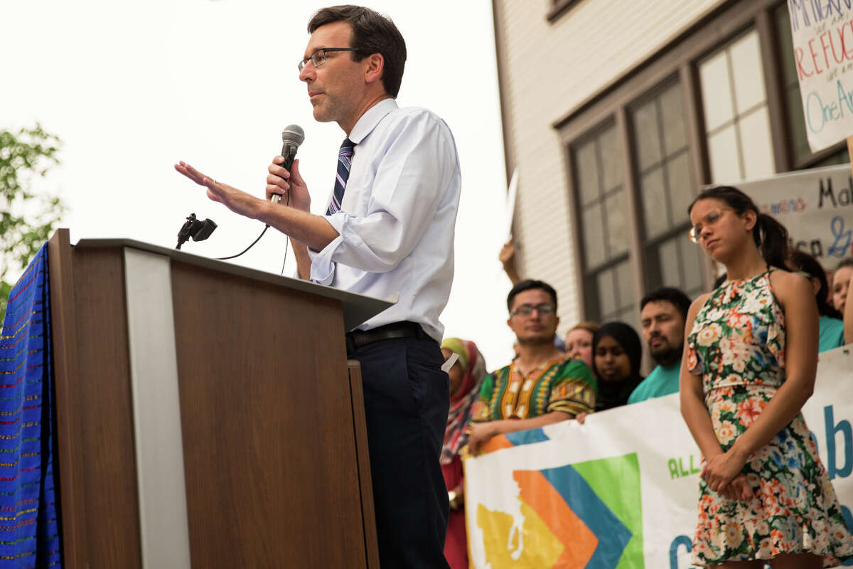 Washington Attorney General Bob Ferguson speaks to the crowd during an immigrant rights rally at El centro de la Raza.  He won a $12 million settlement from Motel 6 after the motel chain unlawfully turned over guest information to ICE agents.