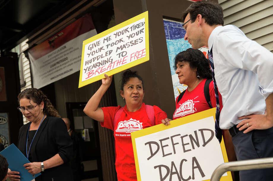 Washington Attorney General Bob Ferguson speaks with Casa Latina representatives during a rally against President Trump's decision to end DACA at El Centro De La Raza. Photo: GRANT HINDSLEY, SEATTLEPI.COM / SEATTLEPI.COM
