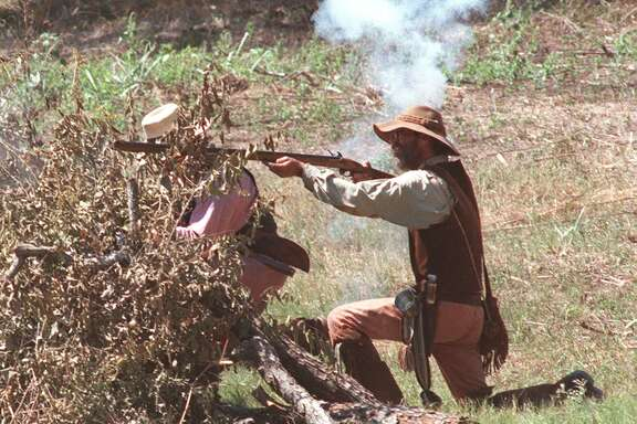 Members of the San Antonio Living History Association dressed as the Texian Troops of Jack Hays fire on Mexican troops of Gen. Adrián Woll in a re-enactment of the Battle of Salado Creek, the last inland invasion of Texas on Sept. 11, 1842. The 1999 re-enactment took place at Victoria's Black Swan Inn on the Salado Creek, the original battleground.