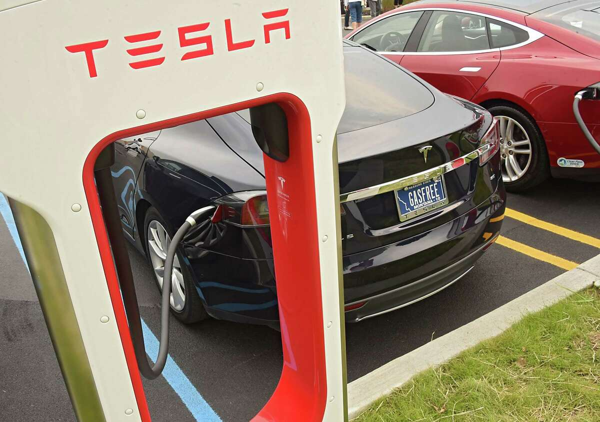 Tesla cars charge up at the largest Supercharger in the Northeast during a ribbon cutting ceremony at Crossgates Mall on Tuesday, Sept. 5, 2017 in Guilderland, N.Y. Senator George Amedore and others addressed the economic benefits of Tesla's investment in the Capital Region and the environmental benefits of expanding New Yorkers' access to zero-emissions vehicles. (Lori Van Buren / Times Union)