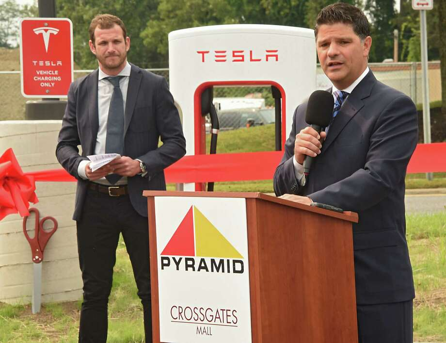 New York State Senator George Amedore speaks during a ribbon cutting ceremony at for the largest Supercharger in the Northeast at Crossgates Mall on Tuesday, Sept. 5, 2017 in Guilderland, N.Y. Senator Amedore and others addressed the economic benefits of Tesla's investment in the Capital Region and the environmental benefits of expanding New Yorkers' access to zero-emissions vehicles. Will Nichols, senior policy manager for Tesla, listens at left. (Lori Van Buren / Times Union) Photo: Lori Van Buren / 20041432A