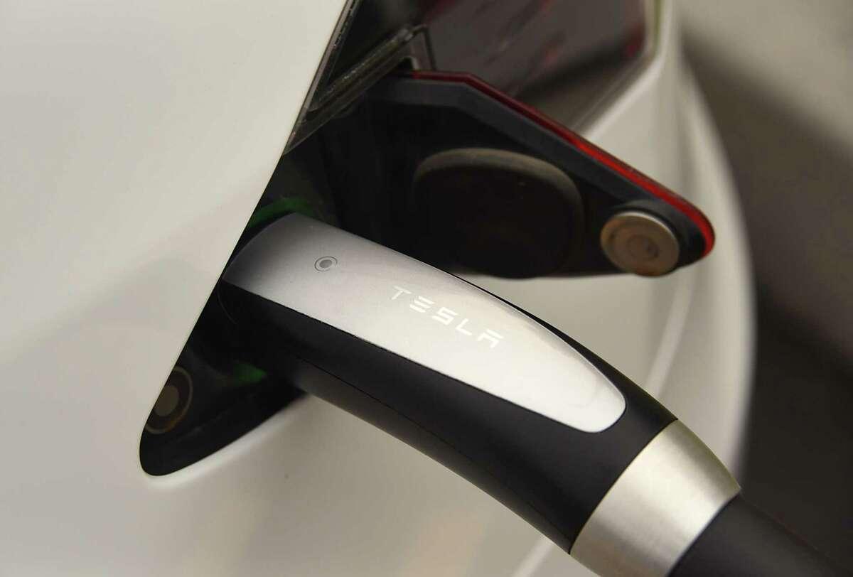 A Tesla car charges. (Lori Van Buren / Times Union)