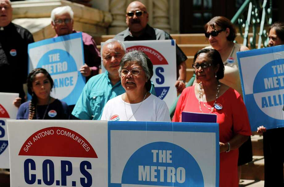 Sister Consuelo Tovar of COPS/Metro Alliance leads a press conference on the steps of city hall asking City Council to increase funding for Project Quest in the upcoming budget and to commit to a wage increase for city employees on Tuesday, Sept. 5, 2017. (Kin Man Hui/San Antonio Express-News) Photo: Kin Man Hui, Staff / San Antonio Express-News / ©2017 San Antonio Express-News