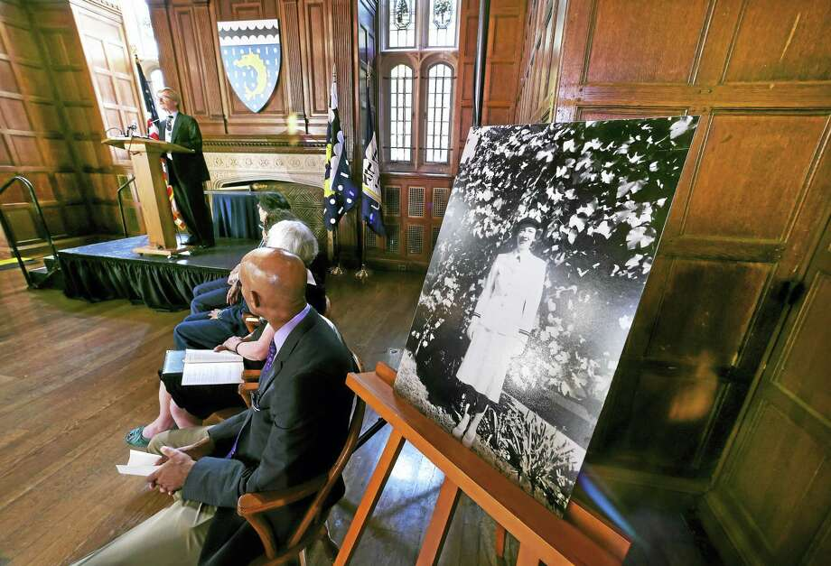 Roger Murray III, left, nephew of Grace Hopper, speaks at the dedication of Grace Hopper College at Yale University in New Haven Tuesday. At right is a photograph of Hopper. Photo: Arnold Gold / Hearst Connecticut Media / New Haven Register