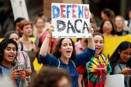 University of California-Berkeley student Whitney Unanue joins a protest march during a pro-DACA rally in Berkeley, Calif., on Tuesday, September 5, 2017.