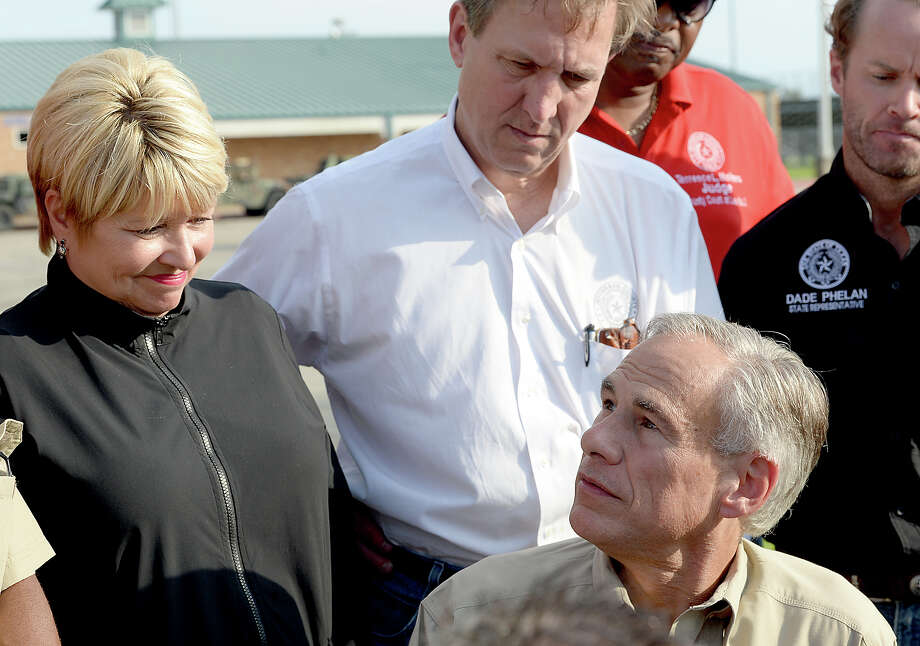 Governor Greg Abbott talks with the media during a stop at the supply distribution site at Ozen High School in Beaumont Tuesday. Photo taken Tuesday, September 5, 2017 Kim Brent/The Enterprise Photo: Kim Brent / BEN