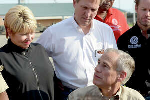 Governor Greg Abbott talks with the media during a stop at the supply distribution site at Ozen High School in Beaumont Tuesday. Photo taken Tuesday, September 5, 2017 Kim Brent/The Enterprise