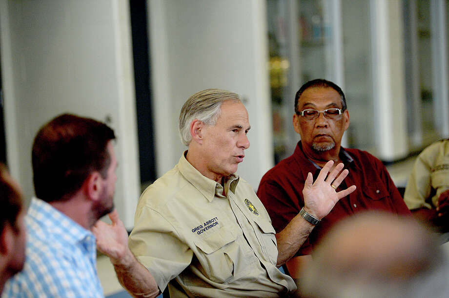 Governor Greg Abbott talks with local officials during a stop at the supply distribution site at Ozen High School in Beaumont Tuesday. Photo taken Tuesday, September 5, 2017 Kim Brent/The Enterprise Photo: Kim Brent / BEN