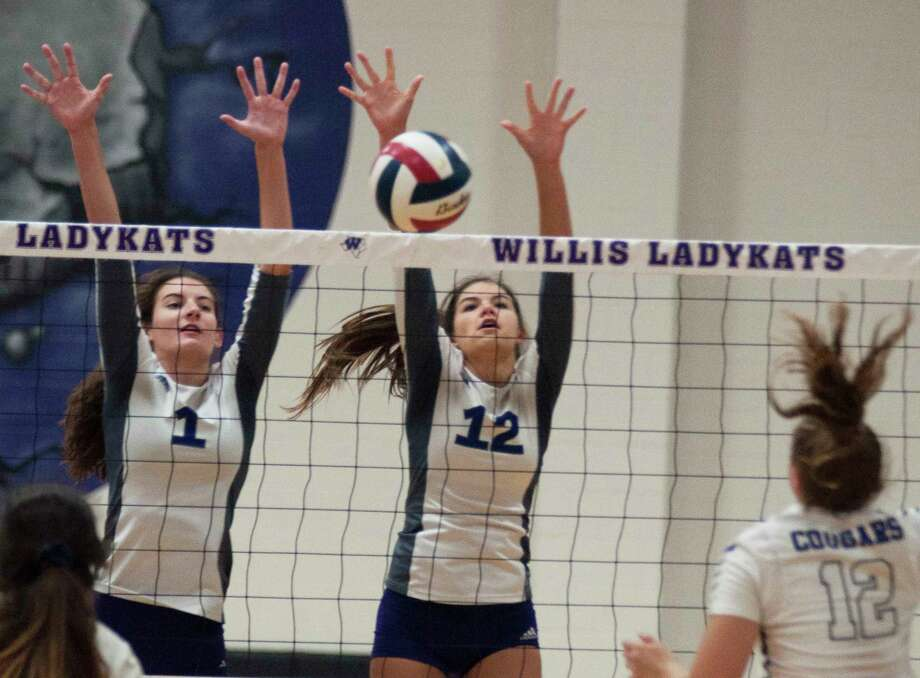 Willis' Makayla Bane and Jaiden Kay combine on the block against College Station on Tuesday at Willis High School. Photo: Keith MacPherson