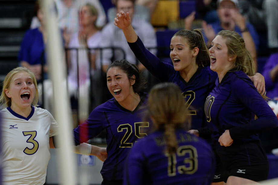 Midland High volleyball players celebrate after winning a second match against Seminole on Sept. 5, 2017, at MHS. James Durbin/Reporter-Telegram Photo: James Durbin