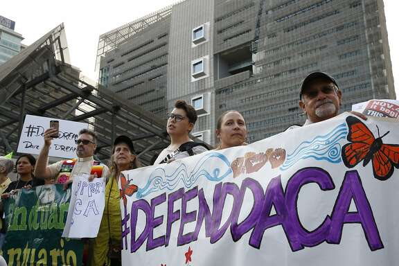People protest outside the San Francisco Federal Building on Tuesday, Sept. 5, 2017, in San Francisco, Calif. Demonstrators rallied in support of the Deferred Action for Childhood Arrivals (DACA) program, which the Trump administration said will phase out in six months.