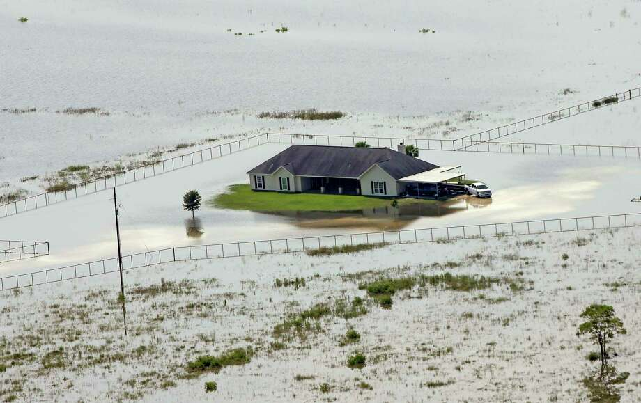 A home is surrounded by floodwaters in the aftermath of Hurricane Harvey Friday, Sept. 1, 2017, near Winnie, Texas. (AP Photo/David J. Phillip) Photo: David J. Phillip, STF / Copyright 2017 The Associated Press. All rights reserved.