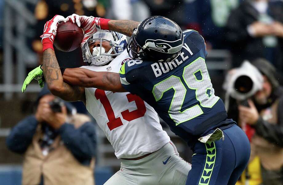 SEATTLE, WA - NOVEMBER 09: Wide receiver Odell Beckham Jr. #13 of the New York Giants catches a pass on defensive back Marcus Burley #28 of the Seattle Seahawks during the second quarter of the game at CenturyLink Field on November 9, 2014 in Seattle, Washington. Photo: Otto Greule Jr, Getty Images / 2014 Getty Images